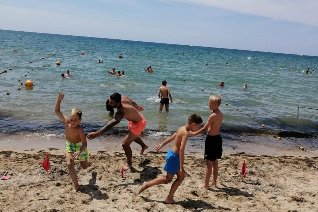 with kids on the beach